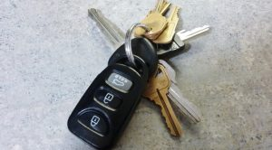 A set of car keys paired with basic auto starters.